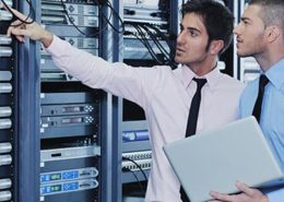 Managed IT solutions provider in network server room solving problems and give help and support.